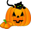 a_black_kitten_climbing_out_of_a_halloween_jackolantern_0515-1008-2023-0012_TN